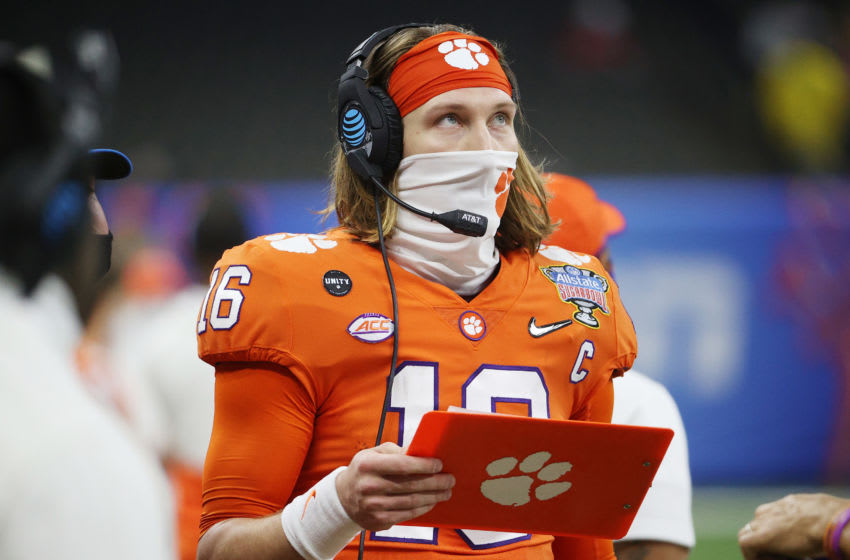 NEW ORLEANS, LOUISIANA - JANUARY 01: Trevor Lawrence #16 of the Clemson Tigers stands on the sideline in the first half against the Ohio State Buckeyes during the College Football Playoff semifinal game at the Allstate Sugar Bowl at Mercedes-Benz Superdome on January 01, 2021 in New Orleans, Louisiana. (Photo by Chris Graythen/Getty Images)