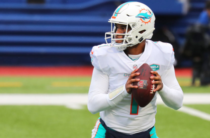 ORCHARD PARK, NEW YORK - JANUARY 03: Tua Tagovailoa #1 of the Miami Dolphins looks to pass against the Buffalo Bills in the first half at Bills Stadium on January 03, 2021 in Orchard Park, New York. (Photo by Timothy T Ludwig/Getty Images)
