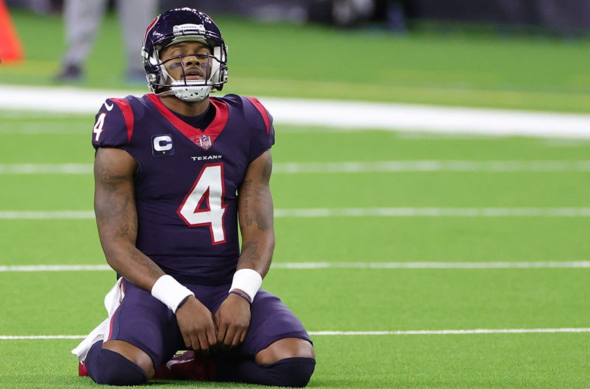 HOUSTON, TEXAS - JANUARY 03: Deshaun Watson #4 of the Houston Texans reacts to a play during a game against the Tennessee Titans at NRG Stadium on January 03, 2021 in Houston, Texas. (Photo by Carmen Mandato/Getty Images)