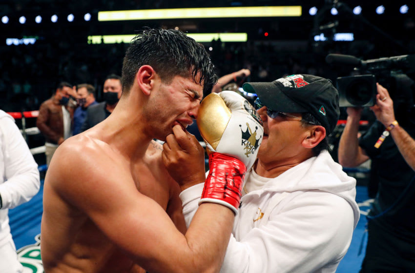 DALLAS, TEXAS - JANUARY 02: Ryan Garcia reacts after knocking out Luke Campbell during the WBC Interim Lightweight Title fight at American Airlines Center on January 02, 2021 in Dallas, Texas. (Photo by Tim Warner/Getty Images)