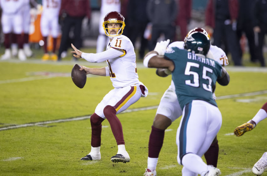 PHILADELPHIA, PA - JANUARY 03: Alex Smith #11 of the Washington Football Team passes the ball against the Philadelphia Eagles at Lincoln Financial Field on January 3, 2021 in Philadelphia, Pennsylvania. (Photo by Mitchell Leff/Getty Images)