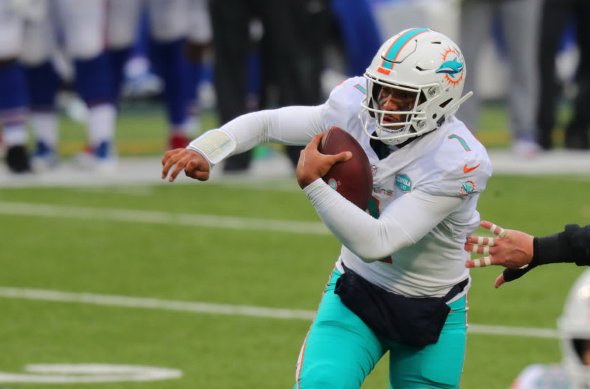 ORCHARD PARK, NY - JANUARY 03: Tua Tagovailoa #1 of the Miami Dolphins runs the ball against the Buffalo Bills at Bills Stadium on January 3, 2021 in Orchard Park, New York. (Photo by Timothy T Ludwig/Getty Images)