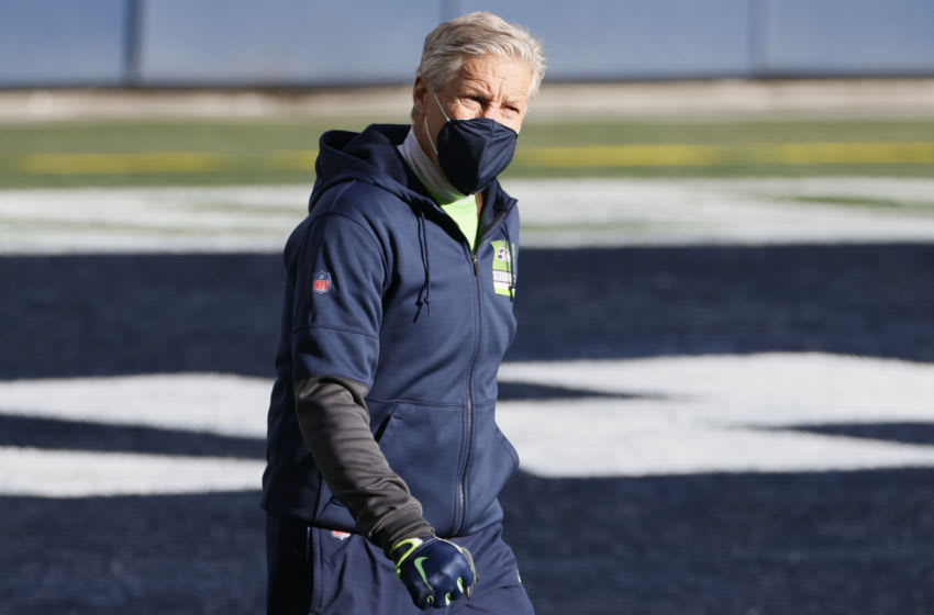 SEATTLE, WASHINGTON - JANUARY 09: Head coach Pete Carroll of the Seattle Seahawks looks on during warm ups prior to the NFC Wild Card Playoff game against the Seattle Seahawks at Lumen Field on January 09, 2021 in Seattle, Washington. (Photo by Steph Chambers/Getty Images)