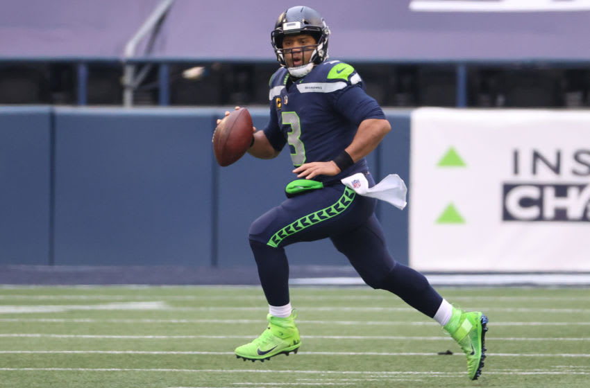 SEATTLE, WASHINGTON - JANUARY 09: Quarterback Russell Wilson #3 of the Seattle Seahawks drops back to pass during the second quarter of the NFC Wild Card Playoff game against the Los Angeles Rams at Lumen Field on January 09, 2021 in Seattle, Washington. (Photo by Abbie Parr/Getty Images)