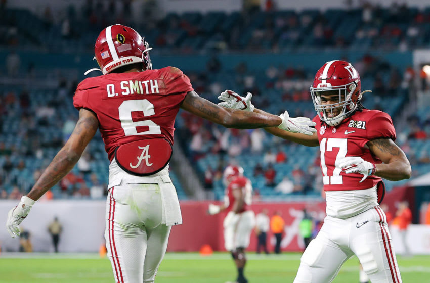 MIAMI GARDENS, FLORIDA - JANUARY 11: DeVonta Smith #6 of the Alabama Crimson Tide celebrates his touchdown with Jaylen Waddle #17 during the second quarter of the College Football Playoff National Championship game against the Ohio State Buckeyes at Hard Rock Stadium on January 11, 2021 in Miami Gardens, Florida. (Photo by Kevin C. Cox/Getty Images)