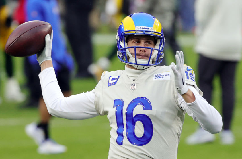 GREEN BAY, WISCONSIN - JANUARY 16: Jared Goff #16 of the Los Angeles Rams warms up before the NFC Divisional Playoff game against the Green Bay Packers at Lambeau Field on January 16, 2021 in Green Bay, Wisconsin. (Photo by Stacy Revere/Getty Images)