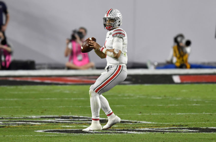 MIAMI GARDENS, FLORIDA - JANUARY 11: Justin Fields #1 of the Ohio State Buckeyes stands in the pocket during the College Football Playoff National Championship football game against the Alabama Crimson Tide at Hard Rock Stadium on January 11, 2021 in Miami Gardens, Florida. The Alabama Crimson Tide defeated the Ohio State Buckeyes 52-24. (Photo by Alika Jenner/Getty Images)