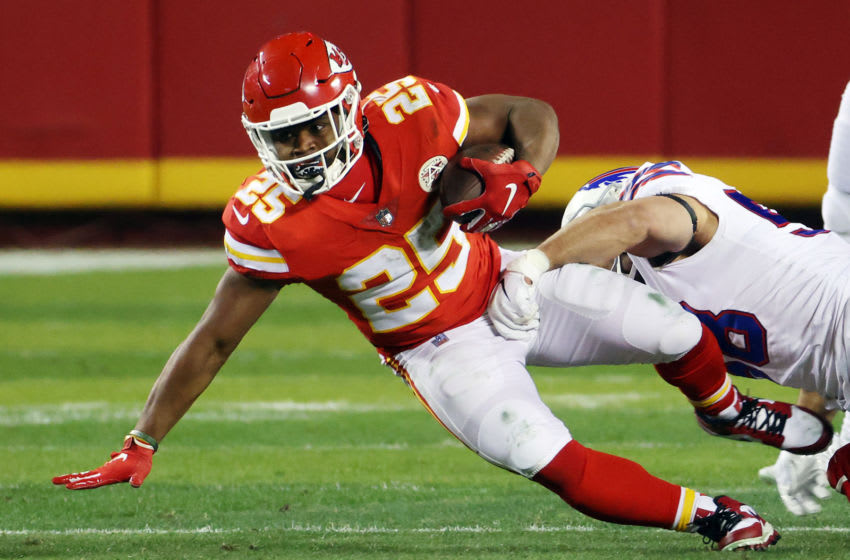 KANSAS CITY, MISSOURI - JANUARY 24: Clyde Edwards-Helaire #25 of the Kansas City Chiefs is tackled by Matt Milano #58 of the Buffalo Bills in the first half during the AFC Championship game at Arrowhead Stadium on January 24, 2021 in Kansas City, Missouri. (Photo by Jamie Squire/Getty Images)
