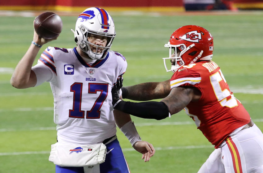 KANSAS CITY, MISSOURI - JANUARY 24: Josh Allen #17 of the Buffalo Bills attempts to pass the ball as he is pressured by Anthony Hitchens #53 of the Kansas City Chiefs in the first half during the AFC Championship game at Arrowhead Stadium on January 24, 2021 in Kansas City, Missouri. (Photo by Jamie Squire/Getty Images)