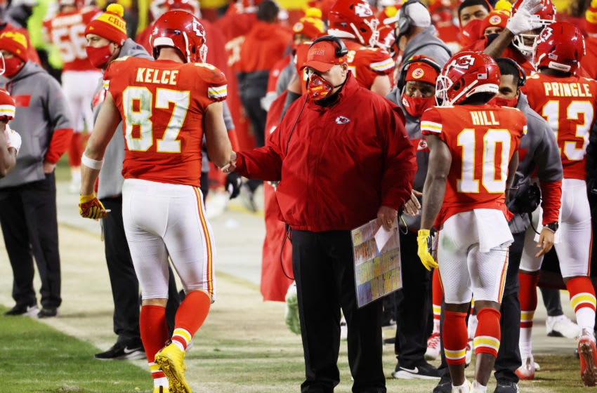 KANSAS CITY, MISSOURI - JANUARY 24: Travis Kelce #87 of the Kansas City Chiefs celebrates with head coach Andy Reid after scoring a fourth quarter touchdown during the AFC Championship game at Arrowhead Stadium on January 24, 2021 in Kansas City, Missouri. (Photo by Jamie Squire/Getty Images)