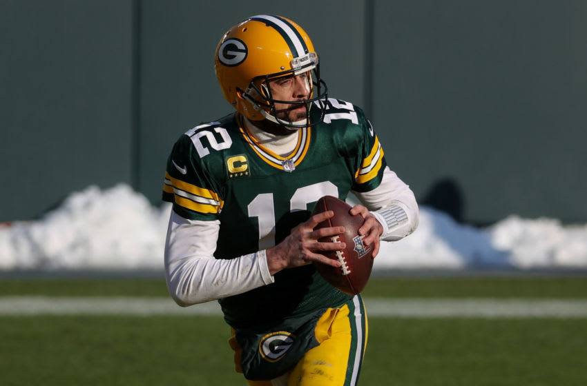GREEN BAY, WISCONSIN - JANUARY 24: Aaron Rodgers #12 of the Green Bay Packers drops back to pass in the first quarter against the Tampa Bay Buccaneers during the NFC Championship game at Lambeau Field on January 24, 2021 in Green Bay, Wisconsin. (Photo by Dylan Buell/Getty Images)