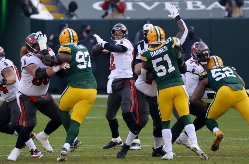GREEN BAY, WISCONSIN - JANUARY 24: Tom Brady #12 of the Tampa Bay Buccaneers throws a pass in the first quarter against the Green Bay Packers during the NFC Championship game at Lambeau Field on January 24, 2021 in Green Bay, Wisconsin. (Photo by Dylan Buell/Getty Images)