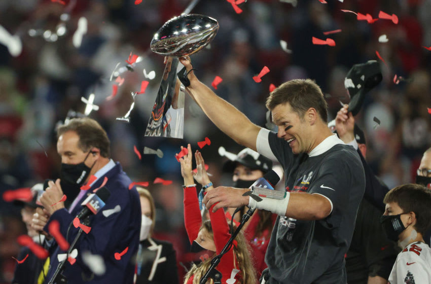 TAMPA, FLORIDA - FEBRUARY 07: Tom Brady #12 of the Tampa Bay Buccaneers hoists the Vince Lombardi Trophy after winning Super Bowl LV at Raymond James Stadium on February 07, 2021 in Tampa, Florida. The Buccaneers defeated the Chiefs 31-9. (Photo by Patrick Smith/Getty Images)