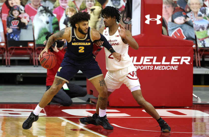 MADISON, WISCONSIN - FEBRUARY 14: Isaiah Livers #2 of the Michigan Wolverines is defended by Aleem Ford #2 of the Wisconsin Badgers during the second half at Kohl Center on February 14, 2021 in Madison, Wisconsin. (Photo by Stacy Revere/Getty Images)
