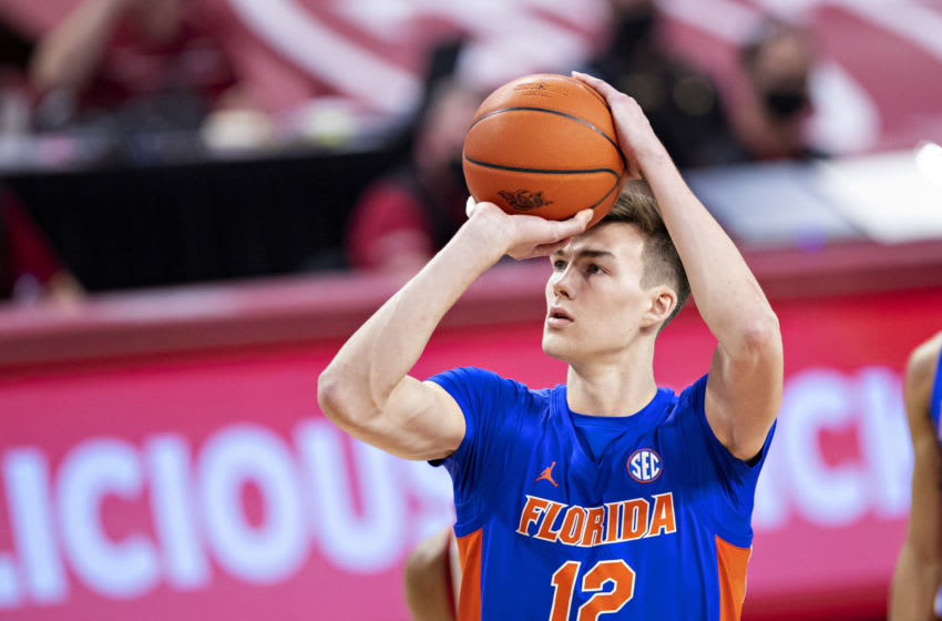 FAYETTEVILLE, ARKANSAS - FEBRUARY 16: Colin Castleton #12 of the Florida Gators shoots a free throw during a game against the Arkansas Razorbacks at Bud Walton Arena on February 16, 2021 in Fayetteville, Arkansas. The Razorbacks defeated the Gators 75-64. (Photo by Wesley Hitt/Getty Images)