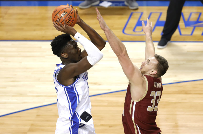 GREENSBORO, NORTH CAROLINA - MARCH 09: Mark Williams #15 of the Duke Blue Devils attempts a jump shot against James Karnik #33 of the Boston College Eagles during the first half of their first round game in the ACC Men's Basketball Tournament at Greensboro Coliseum on March 09, 2021 in Greensboro, North Carolina. (Photo by Jared C. Tilton/Getty Images)
