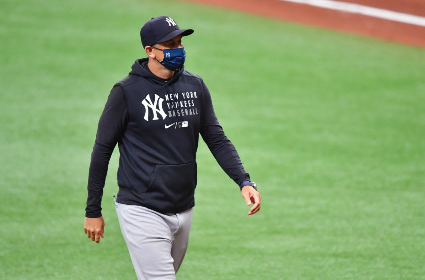 ST PETERSBURG, FLORIDA - APRIL 09: Manager Aaron Boone of the New York Yankees walks back to the dugout after relieving Corey Kluber in the third inning against the Tampa Bay Rays at Tropicana Field on April 09, 2021 in St Petersburg, Florida. (Photo by Julio Aguilar/Getty Images)