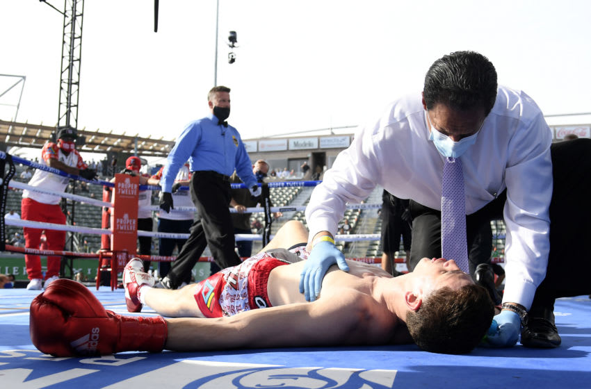 Thomas LaManna receives medical attention after he is knocked out by Erislandy Lara. (Photo by Harry How/Getty Images)