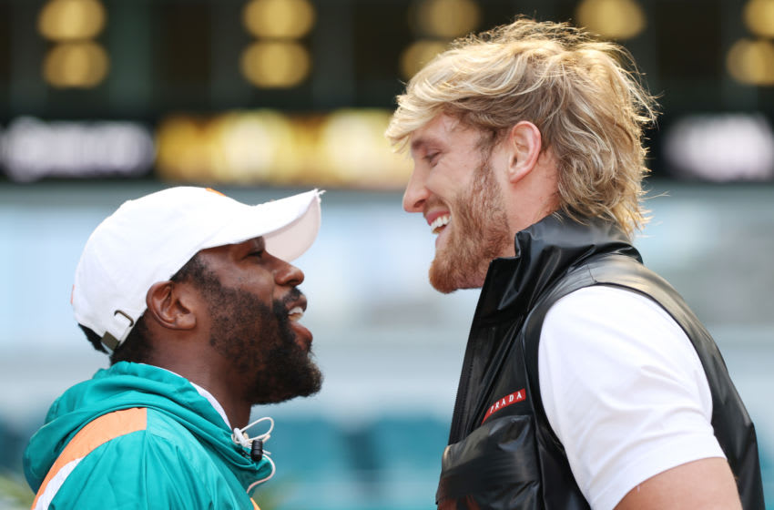 MIAMI GARDENS, FLORIDA - MAY 06: Floyd Mayweather and Logan Paul face off during media availability prior to their June 6 match at Hard Rock Stadium on May 06, 2021 in Miami Gardens, Florida. (Photo by Cliff Hawkins/Getty Images)