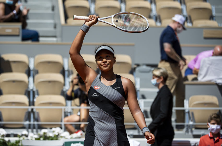 PARIS, FRANCE - MAY 30: Naomi Osaka of Japan celebrates her victory over Patricia Maria Țig of Romania in the first round of the women's singles at Roland Garros on May 30, 2021 in Paris, France.