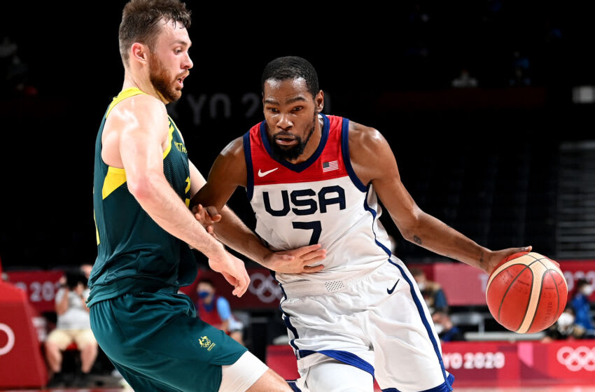 SAITAMA, JAPAN - AUGUST 05: Kevin Durant of the USA takes on the defence of Nic Kay of Australia during the Basketball semi final match between Australia and the USA on day thirteen of the Tokyo 2020 Olympic Games at Saitama Super Arena on August 05, 2021 in Saitama, Japan. (Photo by Bradley Kanaris/Getty Images)