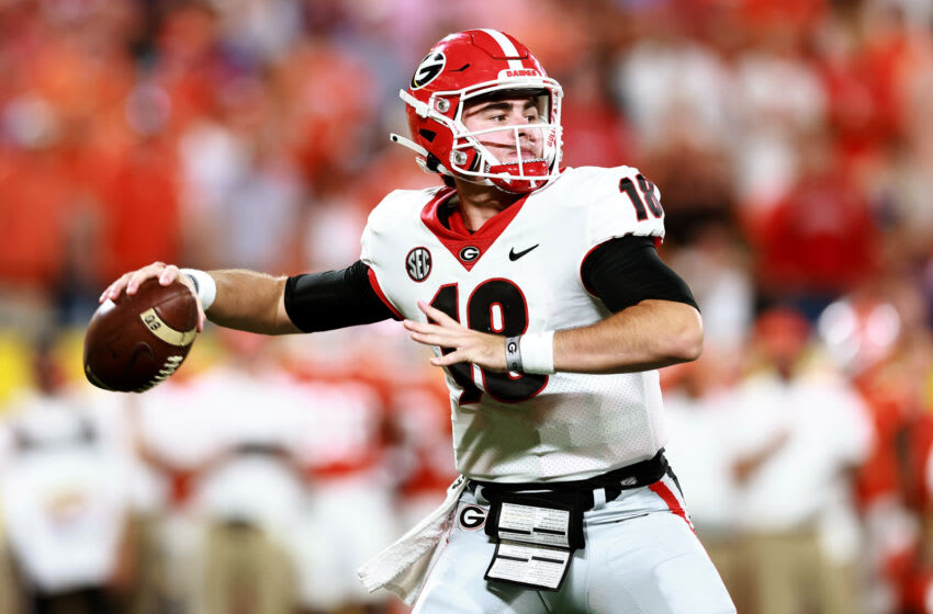 CHARLOTTE, NORTH CAROLINA - SEPTEMBER 04: JT Daniels #18 of the Georgia Bulldogs drops back to pass against the Clemson Tigers during the first half of the Duke's Mayo Classic at Bank of America Stadium on September 04, 2021 in Charlotte, North Carolina. (Photo by Grant Halverson/Getty Images)