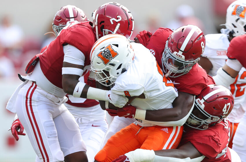 TUSCALOOSA, ALABAMA - SEPTEMBER 11: DeMarcco Hellams #2, Christian Harris #8, and Byron Young #47 of the Alabama Crimson Tide tackle Brandon Marshall #8 of the Mercer Bears during the first half at Bryant-Denny Stadium on September 11, 2021 in Tuscaloosa, Alabama. (Photo by Kevin C. Cox/Getty Images)