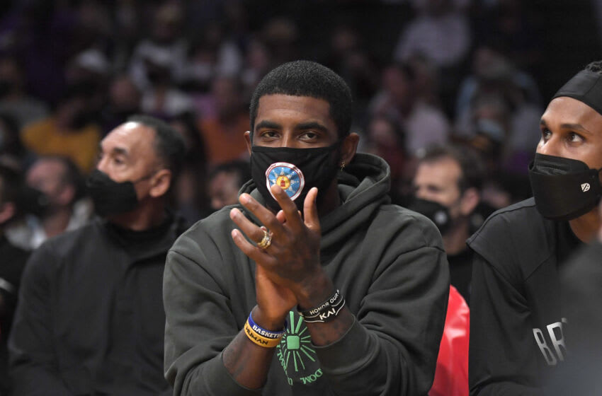LOS ANGELES, CA - OCTOBER 03: Kyrie Irving #11 of the Brooklyn Nets cheers from the bench during a pre season game against the Los Angeles Lakers at Staples Center on October 3, 2021 in Los Angeles, California. NOTE TO USER: User expressly acknowledges and agrees that, by downloading and/or using this Photograph, user is consenting to the terms and conditions of the Getty Images License Agreement. (Photo by Kevork Djansezian/Getty Images)