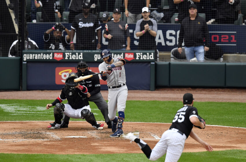 CHICAGO, ILLINOIS - OCTOBER 12: Carlos Correa #1 of the Houston Astros hits a two-run double during the 3rd inning of Game 4 of the American League Division Series against the Chicago White Sox at Guaranteed Rate Field on October 12, 2021 in Chicago, Illinois. (Photo by Quinn Harris/Getty Images)