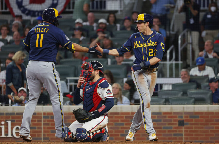 ATLANTA, GEORGIA - OCTOBER 12: Rowdy Tellez #11 of the Milwaukee Brewers high fives Christian Yelich #22 of the Milwaukee Brewers after hitting a two run home run during the fifth inning against the Atlanta Braves in game four of the National League Division Series at Truist Park on October 12, 2021 in Atlanta, Georgia. (Photo by Kevin C. Cox/Getty Images)