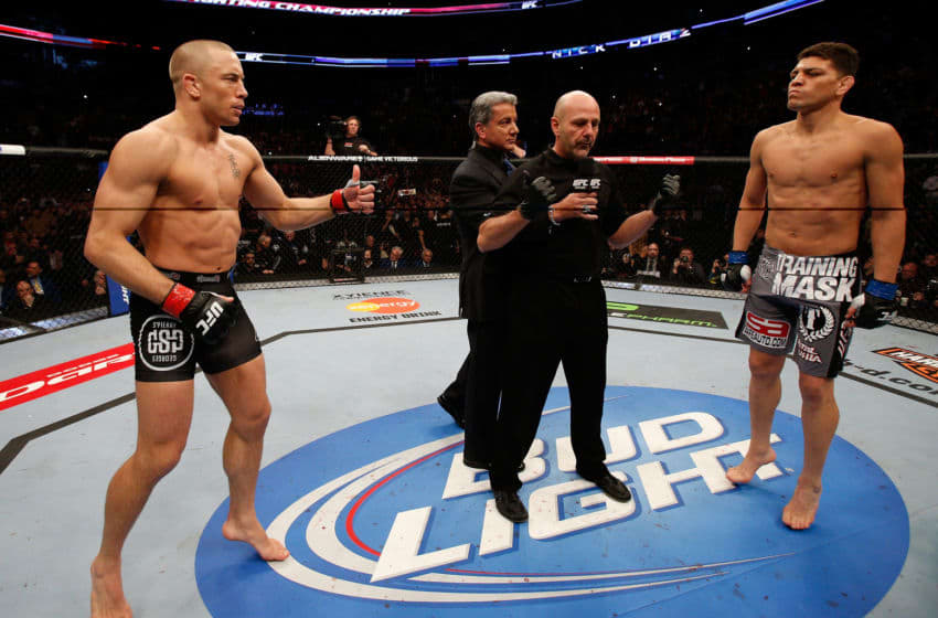 MONTREAL, QC - MARCH 16: (L-R) Opponents Georges St-Pierre and Nick Diaz face off before their welterweight championship bout during the UFC 158 event at Bell Centre on March 16, 2013 in Montreal, Quebec, Canada. (Photo by Josh Hedges/Zuffa LLC/Zuffa LLC via Getty Images)