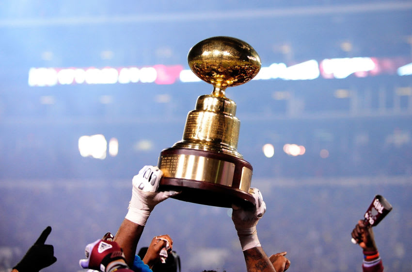 STARKVILLE, MS - NOVEMBER 28: Members of the Mississippi State Bulldogs hold the