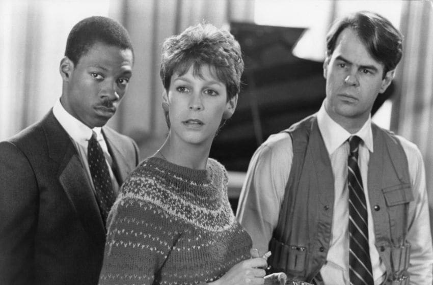 NEW YORK - 1983: L-R Eddie Murphy, Jamie Lee Curtis and Dan Aykroyd in a scene from the Paramount Pictures movie 'Trading Places' in 1983 in New York City, New York. (Photo by Paramount Pictures/Getty Images)