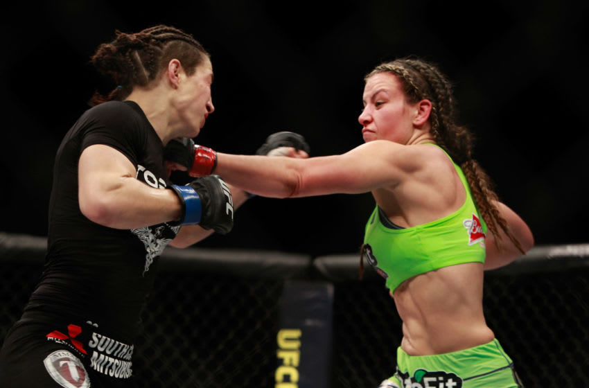 LAS VEGAS, NV - JANUARY 31: Miesha Tate (R) punches Sara McMann in their bantamweight bout during UFC 183 at the MGM Grand Garden Arena on January 31, 2015 in Las Vegas, Nevada. Tate won the fight by majority decision. (Photo by Steve Marcus/Getty Images)