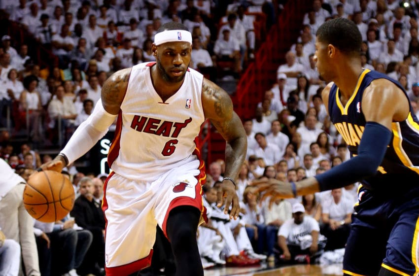 MIAMI, FL - MAY 26: LeBron James #6 of the Miami Heat dribbles the ball as Paul George #24 of the Indiana Pacers defends during Game Four of the Eastern Conference Finals of the 2014 NBA Playoffs at American Airlines Arena on May 26, 2014 in Miami, Florida. NOTE TO USER: User expressly acknowledges and agrees that, by downloading and or using this photograph, User is consenting to the terms and conditions of the Getty Images License Agreement. (Photo by Mike Ehrmann/Getty Images)