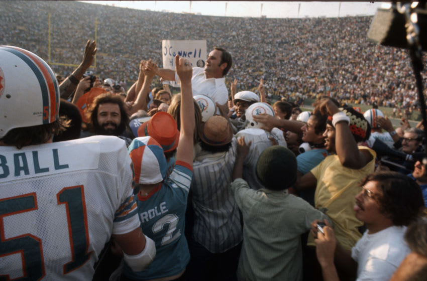 LOS ANGELES, CA - JANUARY 14: Head Coach Don Shula of the Miami Dolphins gets carried off the field by his players after they defeated the Washington Redskins in Super Bowl VII at the Los Angeles Memorial Coliseum in Los Angeles, California, January 14, 1973. The Dolphins won the Super Bowl 14-7. (Photo by Focus on Sport/Getty Images)