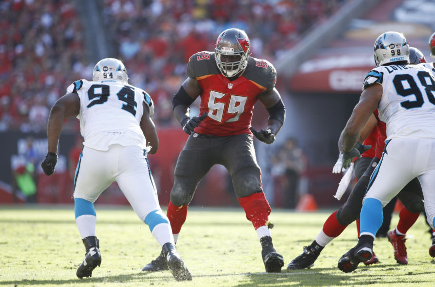 TAMPA, FL - JANUARY 01: Demar Dotson #69 of the Tampa Bay Buccaneers (Photo by Joe Robbins/Getty Images)