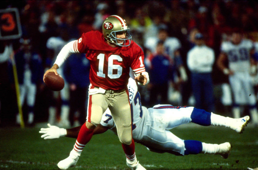 Quarterbackl Joe Montana of the San Francisco 49ers dodges a defender in a 7 to 3 win over the New York Giants on 12/03/1990. (Job 9707) ?Dan Honda 000-004-035 (Photo by Dan Honda/Getty Images) *** Local Caption ***