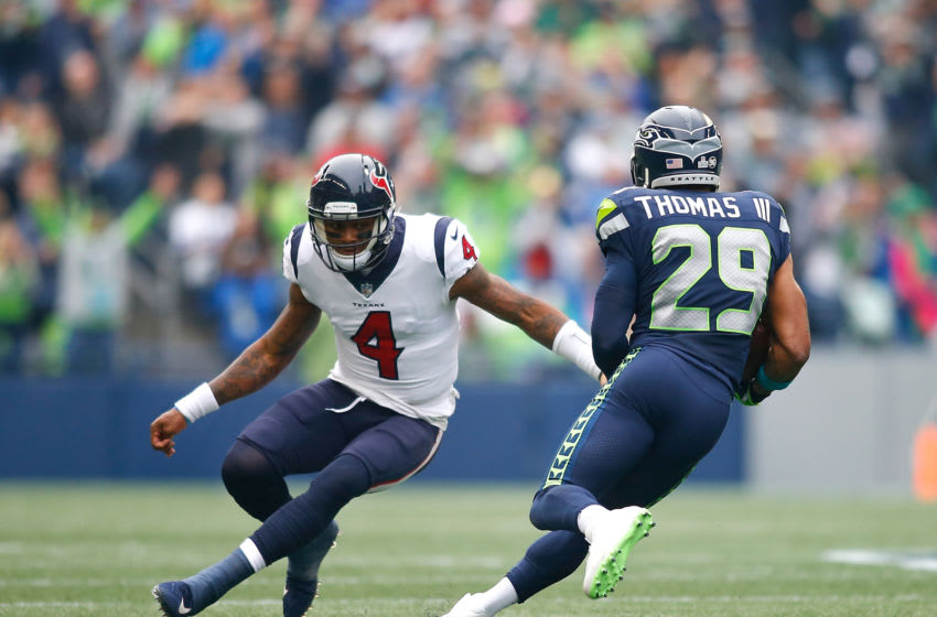SEATTLE, WA - OCTOBER 29: Earl Thomas III of the Seattle Seahawks returns an interception for a touchdown against DeShaun Watson #4 of the Houston Texans at CenturyLink Field on October 29, 2017 in Seattle, Washington. (Photo by Jonathan Ferrey/Getty Images)