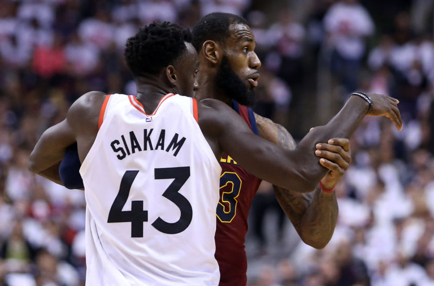 TORONTO, ON - MAY 01: LeBron James #23 of the Cleveland Cavaliers and Pascal Siakam #43 of the Toronto Raptors in the second half of Game One of the Eastern Conference Semifinals during the 2018 NBA Playoffs at Air Canada Centre on May 1, 2018 in Toronto, Canada. NOTE TO USER: User expressly acknowledges and agrees that, by downloading and or using this photograph, User is consenting to the terms and conditions of the Getty Images License Agreement. (Photo by Vaughn Ridley/Getty Images)