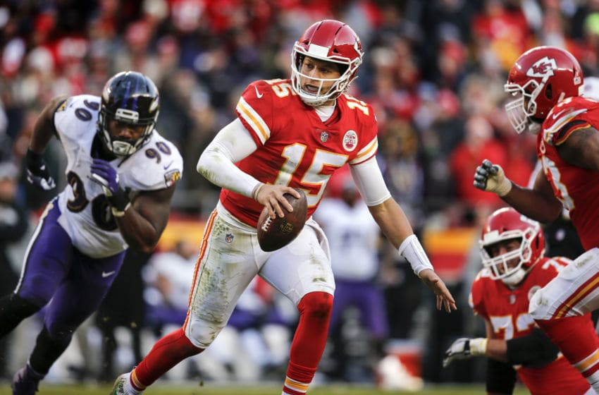 KANSAS CITY, MO - DECEMBER 09: Quarterback Patrick Mahomes #15 of the Kansas City Chiefs scrambles away from outside linebacker Za'Darius Smith #90 of the Baltimore Ravens in overtime at Arrowhead Stadium on December 9, 2018 in Kansas City, Missouri. The Chiefs won, 27-24. (Photo by David Eulitt/Getty Images)