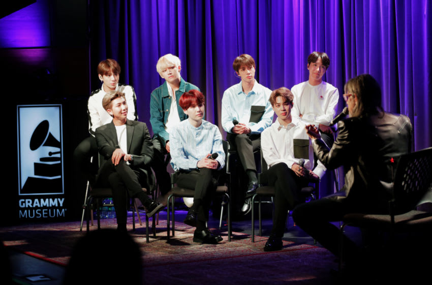 LOS ANGELES, CA - SEPTEMBER 11: (Back row L-R) Jung Kook, V, Jin, j-jope, (front row L-R) RM, SUGA, and Jimin of BTS speak with GRAMMY Museum Artistic Director Scott Goldman at A Conversation With BTS at the GRAMMY Museum on September 11, 2018 in Los Angeles, California. (Photo by Rebecca Sapp/WireImage)