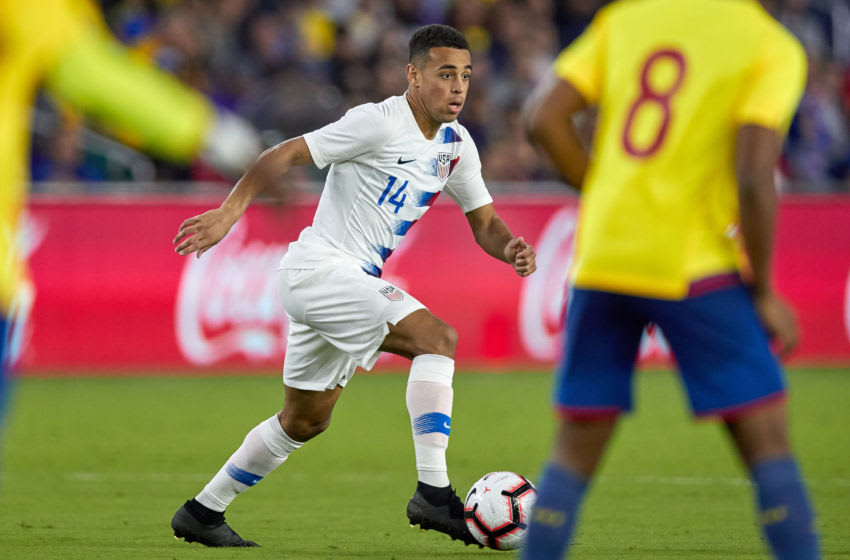 ORLANDO, FL - MARCH 21: United States midfielder Tyler Adams (14) dribbles the ball in game action during an International friendly match between the United States and Ecuador on March 21, 2019 at Orlando City Stadium in Orlando, FL. (Photo by Robin Alam/Icon Sportswire via Getty Images)