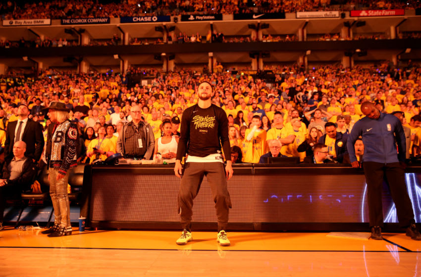 OAKLAND, CALIFORNIA - APRIL 13: Stephen Curry #30 of the Golden State Warriors stands on the side of the court during player introductions before their game against the LA Clippers during Game One of the first round of the 2019 NBA Western Conference Playoffs at ORACLE Arena on April 13, 2019 in Oakland, California. NOTE TO USER: User expressly acknowledges and agrees that, by downloading and or using this photograph, User is consenting to the terms and conditions of the Getty Images License Agreement. (Photo by Ezra Shaw/Getty Images)