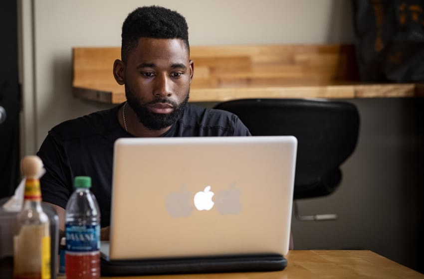 BOSTON, MA - JULY 16: Jackie Bradley Jr. #19 of the Boston Red Sox works on a laptop before a game against the Toronto Blue Jays on July 16, 2019 at Fenway Park in Boston, Massachusetts. (Photo by Billie Weiss/Boston Red Sox/Getty Images)