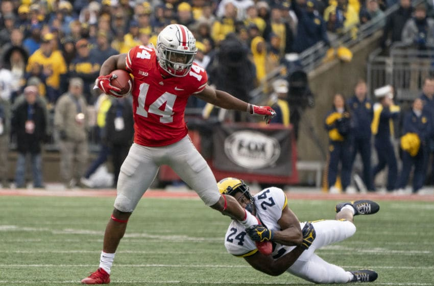 COLUMBUS, OH - NOVEMBER 24: Ohio State Buckeyes wide receiver K.J. Hill (14) runs with the ball while Michigan Wolverines defensive back Lavert Hill (24 attempts to tackle him during the second quarter at Ohio Stadium on November 24, 2018. (Photo by Jason Mowry/Icon Sportswire via Getty Images)