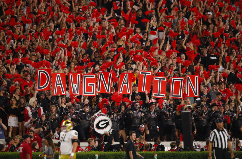ATHENS, GA - SEPTEMBER 21: Georgia Bulldogs fans hold up