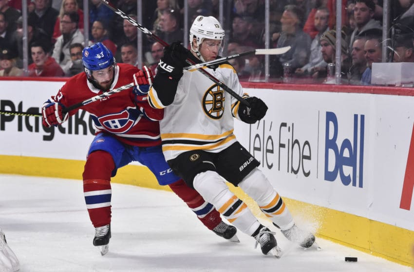MONTREAL, QC - NOVEMBER 05: Victor Mete #53 of the Montreal Canadiens and Charlie Coyle #13 of the Boston Bruins skate after the puck during the third period at the Bell Centre on November 5, 2019 in Montreal, Canada. The Montreal Canadiens defeated the Boston Bruins 5-4. (Photo by Minas Panagiotakis/Getty Images)