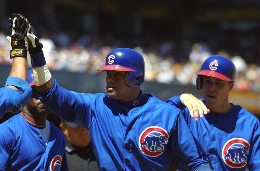 Chicago Cubs' Sammy Sosa is congratulated at the plate by teammates after he hit a three-run homer off San Francisco Giants' Livan Hernandez in the fifth inning 29 April 2001 in San Francisco, Ca. AFP PHOTO/Monica M. DAVEY (Photo by MONICA DAVEY / AFP) (Photo credit should read MONICA DAVEY/AFP via Getty Images)