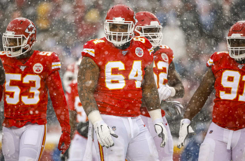 KANSAS CITY, MO - DECEMBER 15: Mike Pennel #64 of the Kansas City Chiefs listens to his teammates during the fourth quarter against the Denver Broncos at Arrowhead Stadium on December 15, 2019 in Kansas City, Missouri. (Photo by David Eulitt/Getty Images)